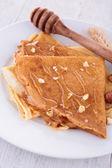 Crepe and honey — Stock Photo