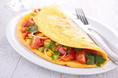 Omelette filled with vegetables — Stock Photo