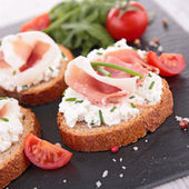 Canape, bread and prosciutto — Stock Photo
