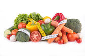 Raw vegetables and measuring tape — Stock Photo
