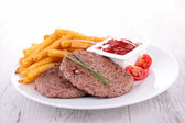 Beef and french fries — Stock Photo