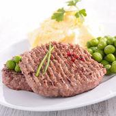 Beefsteak, mashed potatoes and pea — Stock Photo