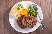 Beefsteak, mashed potatoes and pea — Stock Photo