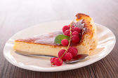 Cheesecake slice and redcurrant — Stockfoto