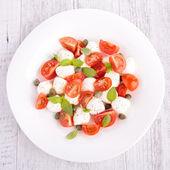 Tomato, mozzarella and basil — Stock Photo