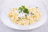 Pasta and cream — Stock Photo