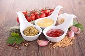 Mustard,ketchup and pesto sauce — Stock Photo