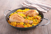 Paella with chicken legs — Stock Photo