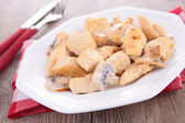 Chicken cooked with cream and mushrooms — Stock Photo