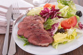 Vegetable salad with meat — Stock Photo