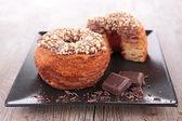 Donut-cronut with chocolate — Stock Photo