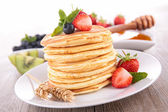 Pancakes and fruits — Stock Photo