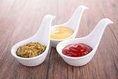 Condiment, ketchup, mustard and pesto sauce — Stock Photo