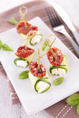 Appetizers  with dried tomatoes — Stock Photo