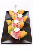 Melon, prosciutto and mozzarella — Stock Photo