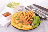 Omelet and fries — Stock Photo