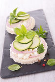 Canape with cucumbers — Stock Photo