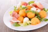 Salad with melon,prosciutto and mozzarella — Stock Photo