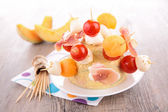 Salad with melon,prosciutto and mozzarella — Photo