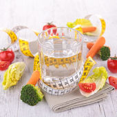 Water and dietetic vegetable — Stock Photo