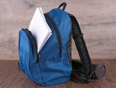 Backpack and paper — Stock fotografie