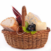 Wicker basket with bread,cheese and sausage — Stock Photo