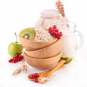 Muesli with fruit and milk — Stock Photo