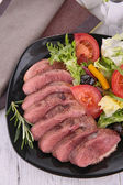 Meat sliced and salad — Stock Photo