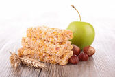 Granola with nuts and apple — Stock Photo