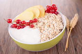 Cornflakes with yogurt and fruits — Stock Photo