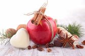 Red apple, biscuit and spices — Stock Photo