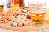 Finger food and alcohol — Stock Photo