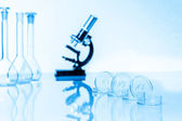 Microscope and test tubes used in research laboratory — Stock Photo