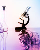 Microscope and test tubes used in laboratory — Stock Photo