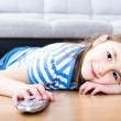 Cute little girl  watching tv on sofa — Stock Photo