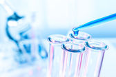 Pipette and test tube on blue background — Stock Photo