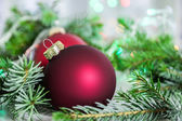 Closeup of christmas balls and christmas tree — Stock Photo