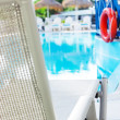 Lifebuoy hanging on a wooden beam at the pool — Stock Photo