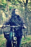 Little girl with bike .Vintage Background — ストック写真