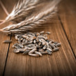 Wheat grain in wooden table — Stock Photo #39242569