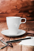 Coffee Cup and office supplies on old wood table — Stock Photo