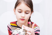 Little girl preparing food in bowl using wire whisk — Stock Photo