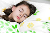 Adorable little girl sleep in the bed — Stock Photo