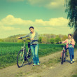 Young girl with mother on bikes in the countryside. — Stock Photo #46515097