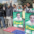 Friends and Relatives of Ebad-ur-Rehman chant slogans against CIA agent Raymond A Davis who killed and crushed Ebad-ur-Rehman by his vehicle - Stock Photo