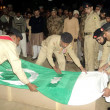 Pak Army Officials cover coffin of Captain Iqrar Ali with  National flag, in Tando Jam - Stock Photo
