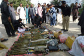 Police officials show seized weapons suicide jackets and explosive material — Stock Photo