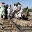 Stock Photo: Laborers busy in mending railway track near Malir Halt railway crossing