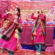 Students wear traditional dresses dance on traditional tunes during tableau ceremony to celebrate Sindhi Cultural Day — Stock Photo #17473175