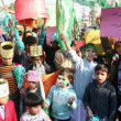 Children supporters of Tehreek-e-Minhaj-ul-Qurchant slogans in favor of Minhaj-ul-Qur'International — Stock Photo #17654603